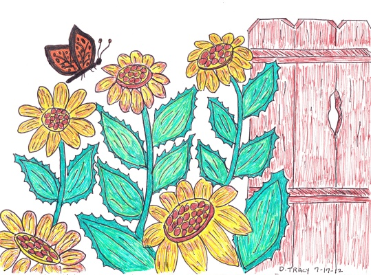 sunflowers and fence