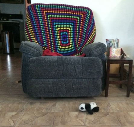 panda in front of recliner