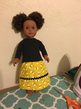 doll with yellow skirt